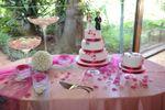 Mesa com o bolo de casamento